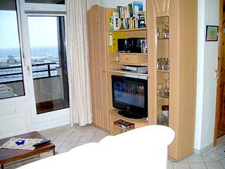 Seeblick damp das apartment for Wohnzimmerschrank mit bettfunktion